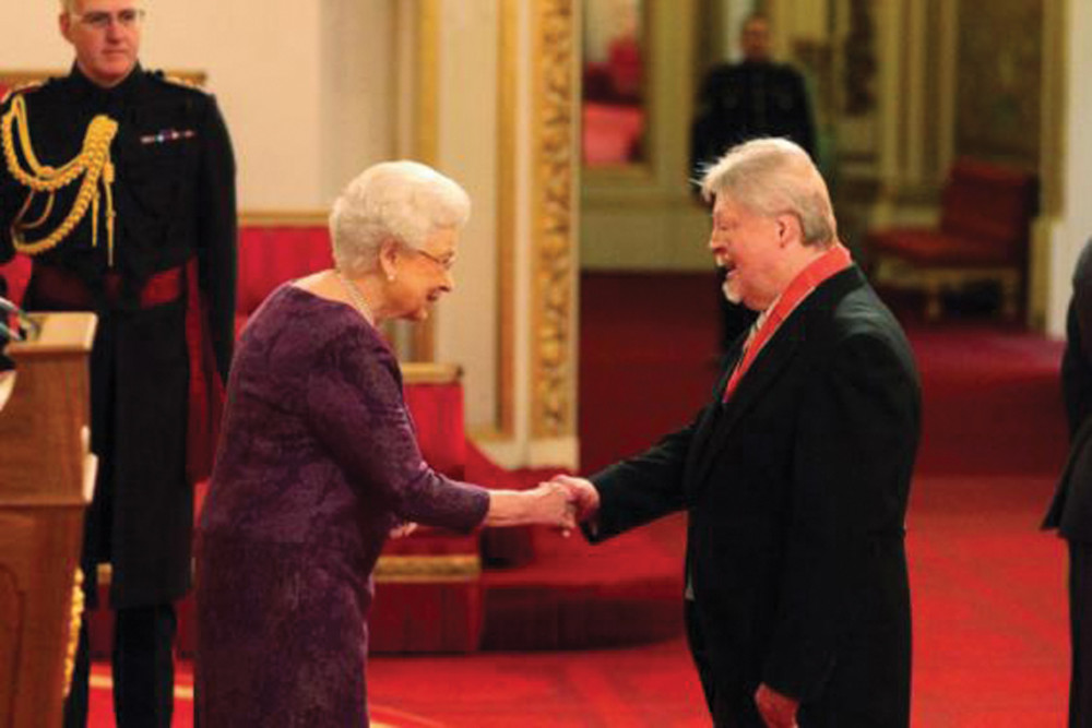 Simon was awarded the CBE for his charitable work